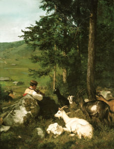 Ziegenherde ruht am Waldrand, Der hirte spielt sitzend an einen großen Findling geleht auf einer Flöte.
