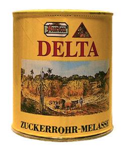 Farbfoto: Konservendose mit Zuckerrohr-Melasse, Etikett mit Zuckerrohrernte-Bild