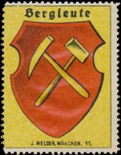 Zunftzeichen der Bergleute: gelbe Spitzhacke und Hammer auf orangenem Untergrund