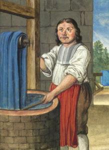 farbige Buchmalerei: Färber an Blaufärbetauchbecken mit Färbestock zieht blau gefärbten Stoff mittels einer Winde aus der aus deem Farbbad