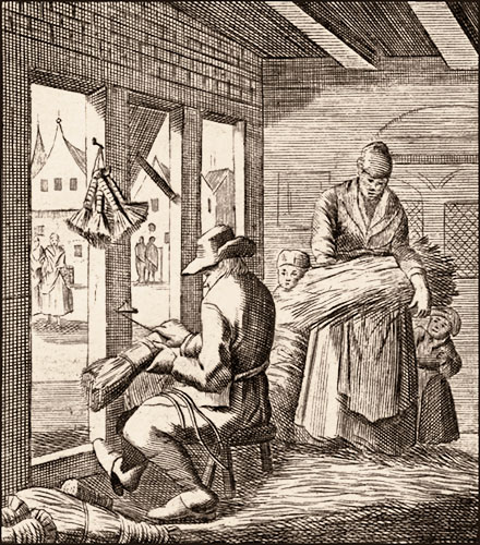 Kupferstich: Mann bindet Besen am Werkstattfenster, Frau bringt weiteres Reisig