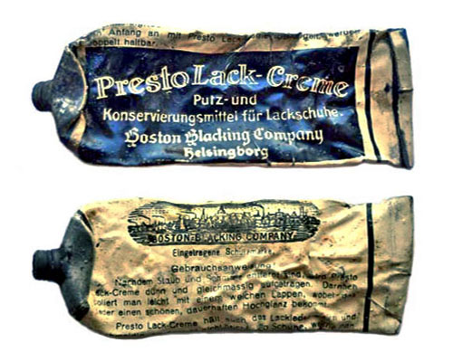 Farbfoto: alte ausgequetschte Schuhcremetube