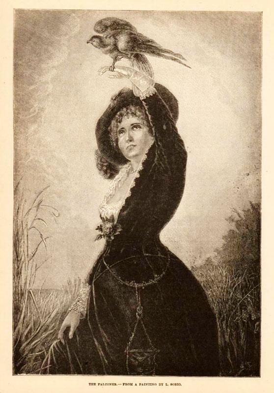 Falknerin im schicken Kleid mit Falke auf der Hand