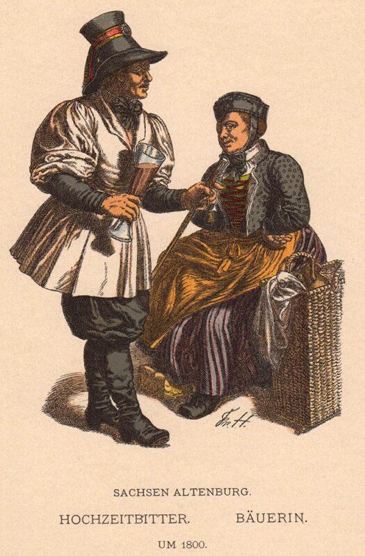 Mann mit Getränk in der Hand und Frau auf Korb sitzend